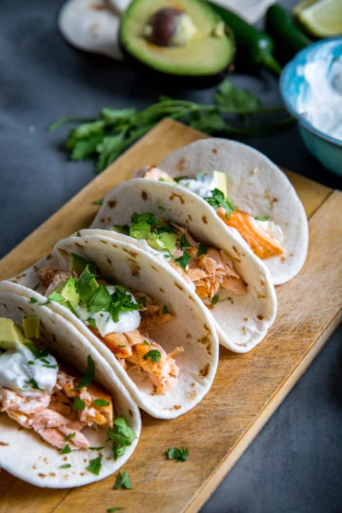 salmon tacos on a wood plank