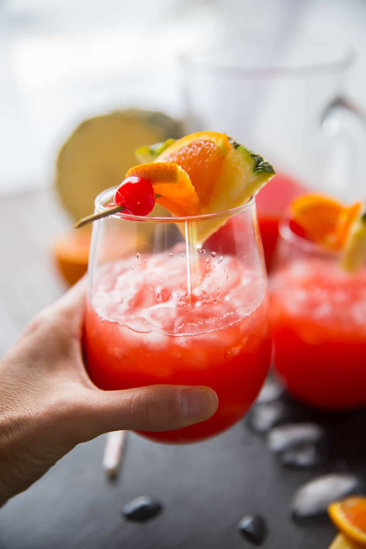 A rum punch recipe that is sure to be a hit at parties! Make an extra large pitcher!