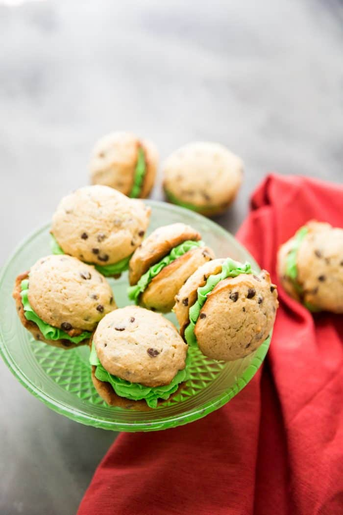 Mint chocolate chip whoopie pies on green plate