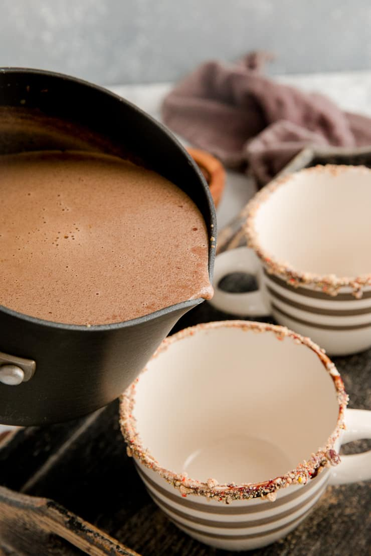 hot chocolate getting poured into a mug