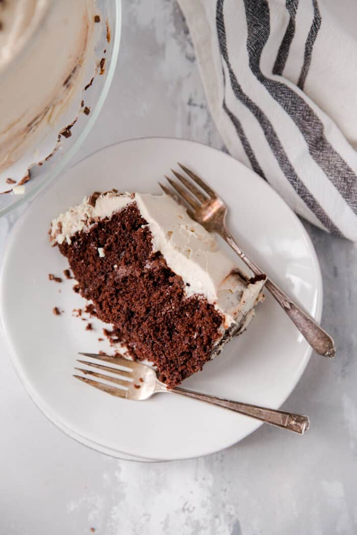slice of chocolate cake with two forks