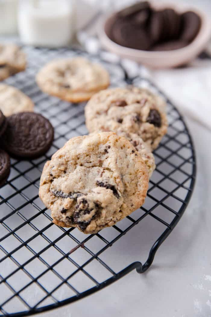 close up of one cookies and cream cookie on a baking rack