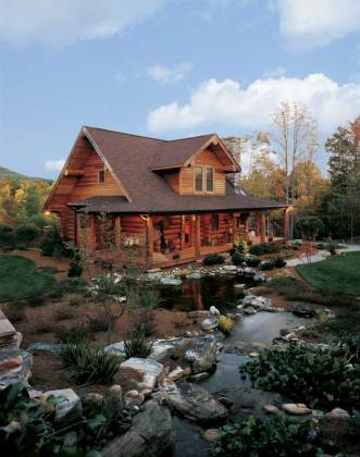 A Log Cabin in North Carolina  Perfect for Outdoor Log Home Living The water garden Cory Snow designed meanders through the front yard   creating a unique setting for the Craftsman style log bungalow