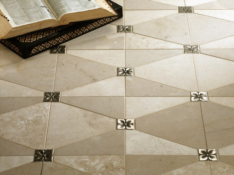 Metal Accent Tiles   Bronzework Studio   Lowitz   Company Metal accent tiles  Blooming Leaf in Traditional Bronze with cream limestone