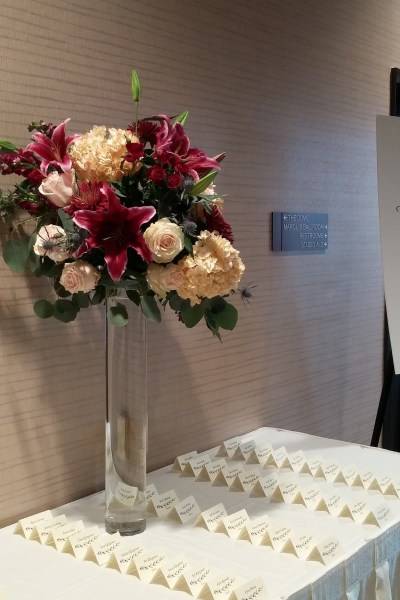 Millennium Hotel  place card table  large arrangement  wedding     Millennium Hotel  place card table  large arrangement  wedding flowers   burgundy and blush  escort card table  sumatra lilies