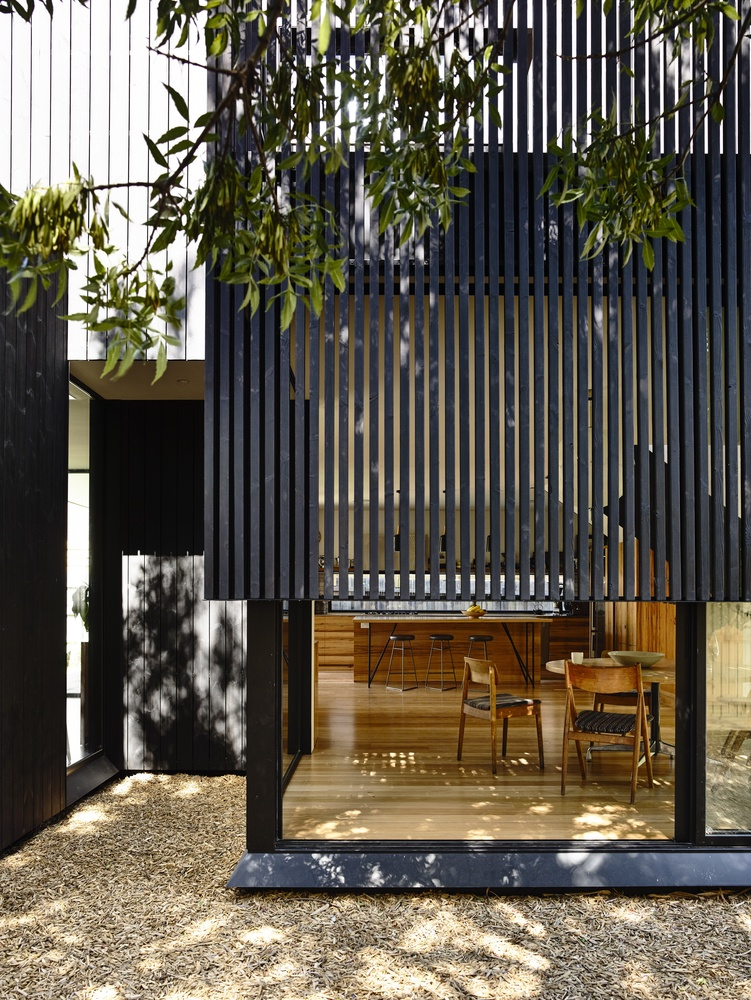 An Elegant Black Timber Extension Compliments A 19th
