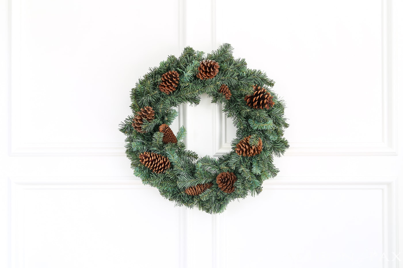 1 Affordable Wreath  5 Easy Ways   Maison de Pax insert pine cones into a cheap wreath to great a gorgeous  expensive look   and