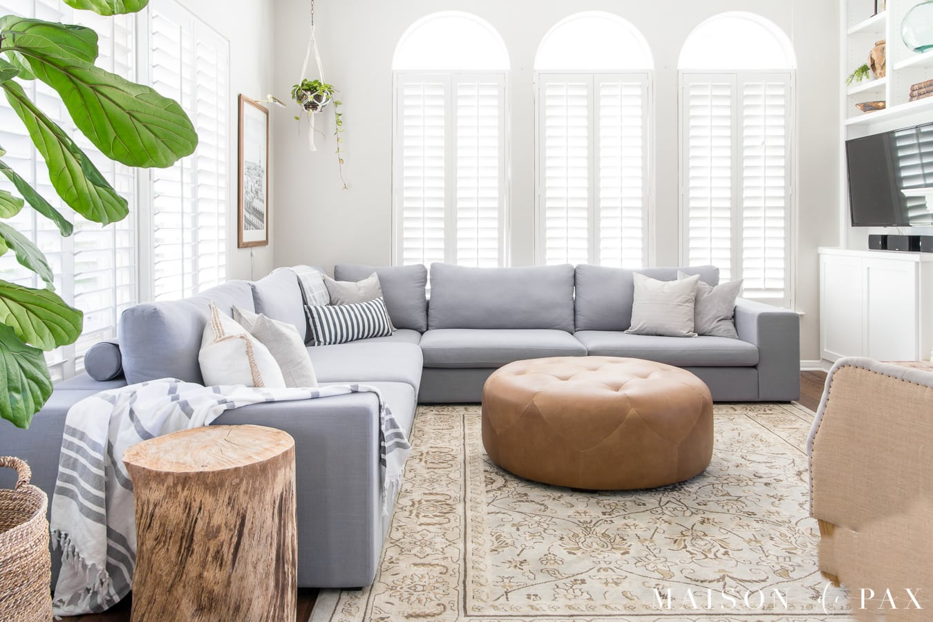 Designing a Small Living Room with a Large Sectional   Maison de Pax This light bright living room is anchored by a large blue gray sectional  and accented with