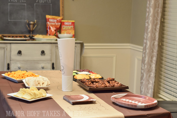 Football themed party table set up. An easy to throw party for the Big Game. Features easy party ideas for snacks, dips and decor. Includes a recipe for Roasted Red Pepper Hummus without seeds! #BigGameSnacks #collectiveBias #ad