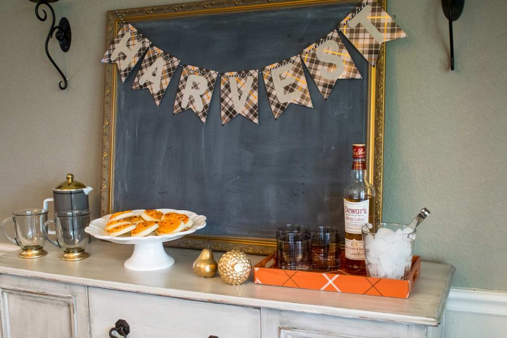Place desserts and drinks on a buffet for fall guests
