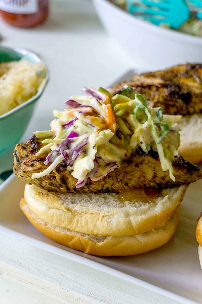 Jerk chicken with mango chipotle slaw sandwiches are perfect for your summer bbq!