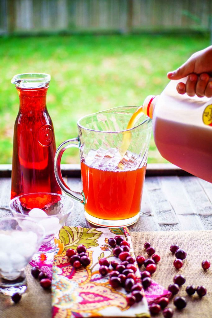 Mixing cranberry tea punch