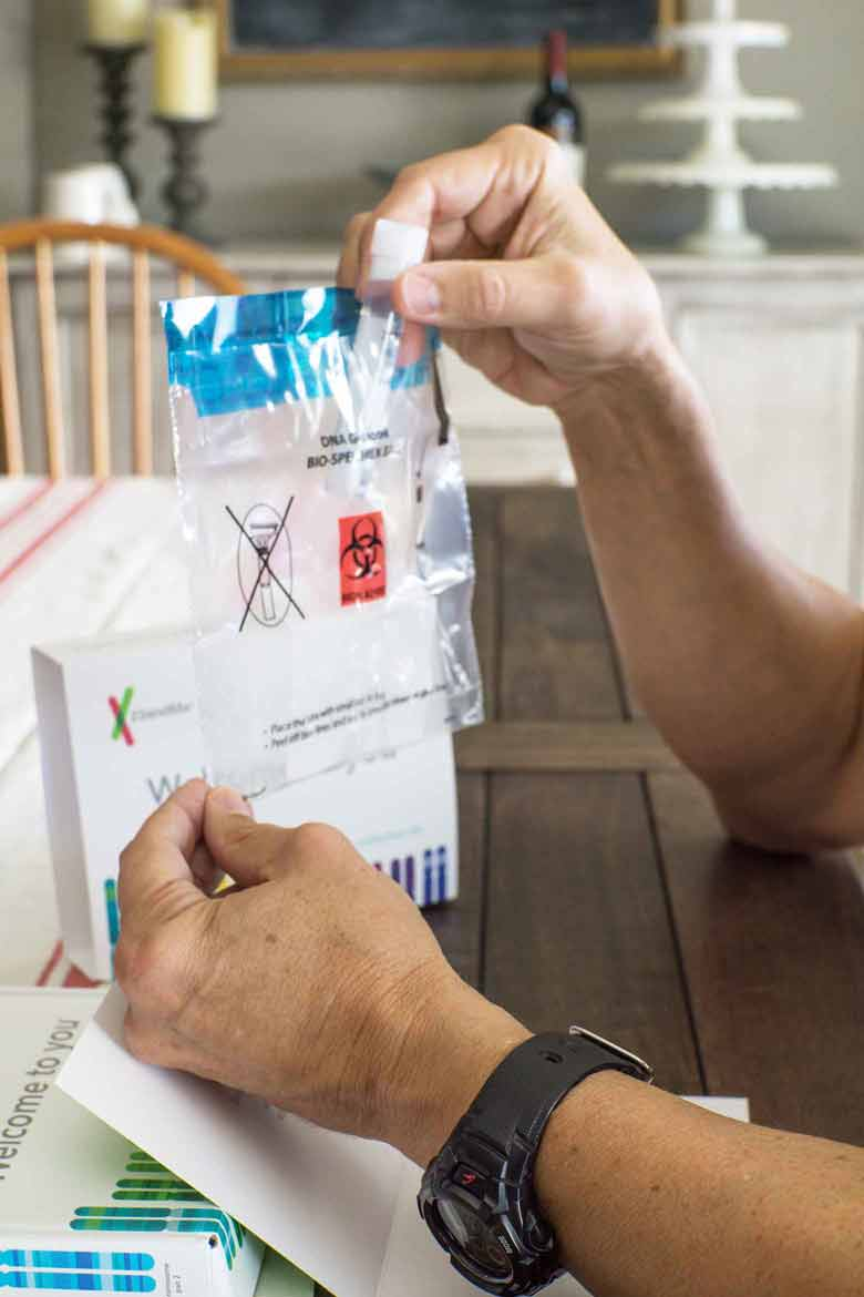 Place a DNA test tube in a biohazard bag before mailing