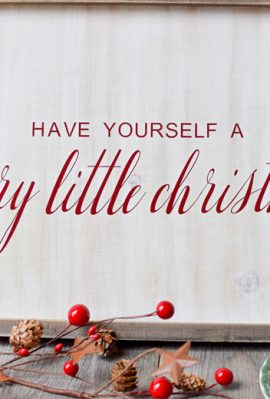 """wooden whitewashed farmhouse sign with """"have yourself a merry little christmas"""" in vinyl from an SVG file"""
