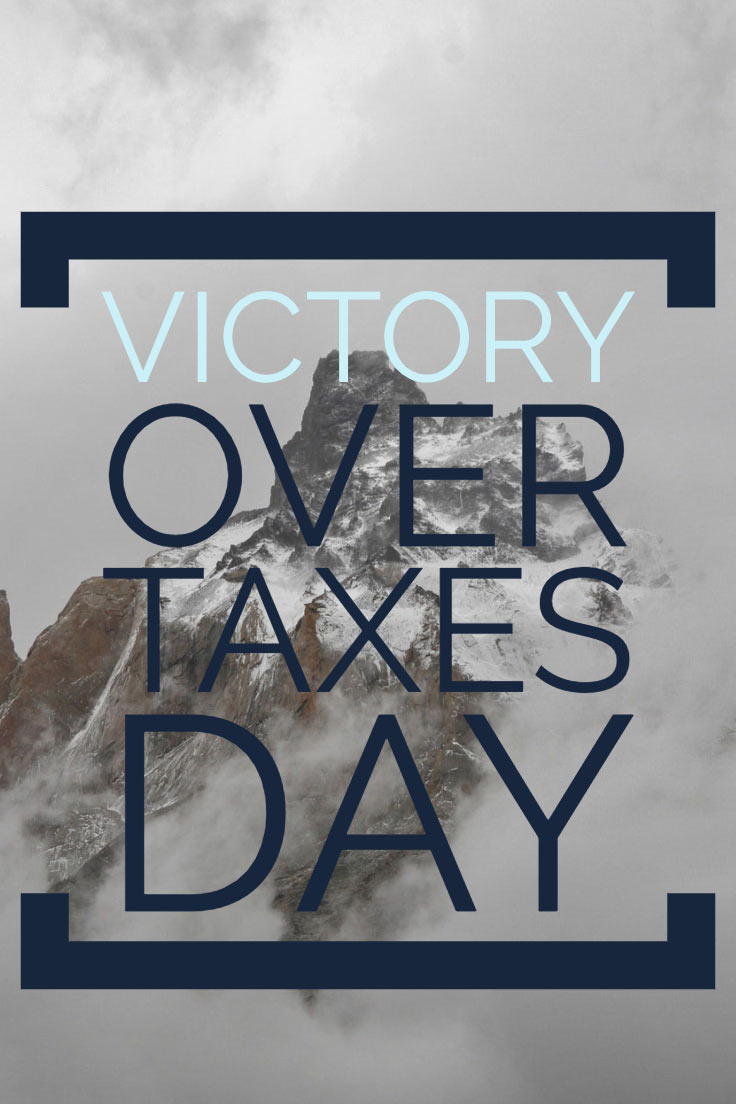 mountain top in clouds with the words victory over taxes day