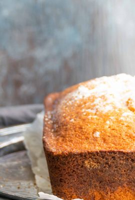 pumpkin pie spice loaf cake sprinkled with confectioners sugar