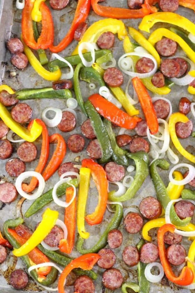sausage and peppers roasted on a baking sheet