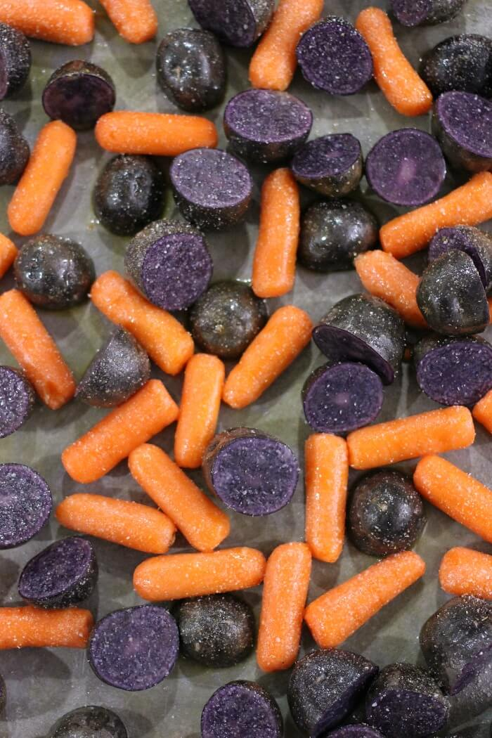 ROASTED PURPLE POTATOES AND CARROTS WITH GARLIC AND BUTTER