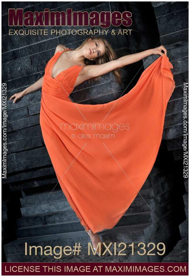 Stock photo: Beautiful Woman in Orange Dress   MaximImages ...