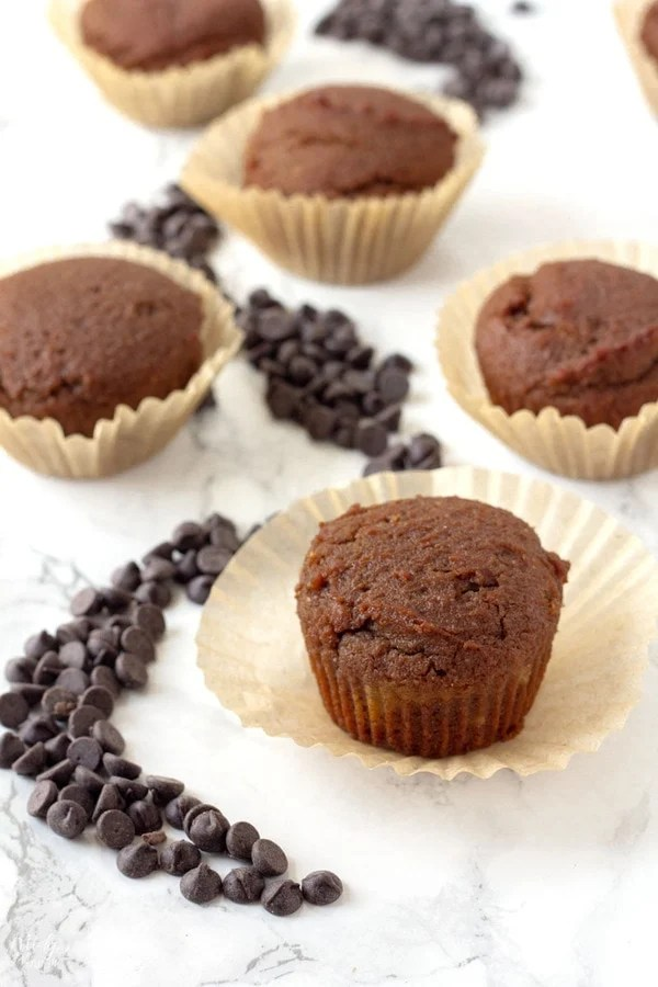 keto chocolate cupcakes fresh out of the oven in a cupcake wrapper