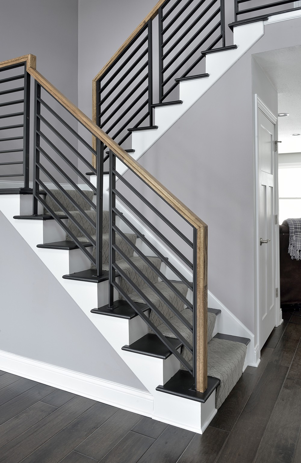 5 Stunning Stairway Trends For Your Home The Money Pit   Stair Banisters And Railings   Baby Proof   Rustic   Split Level   Pinterest   Landing