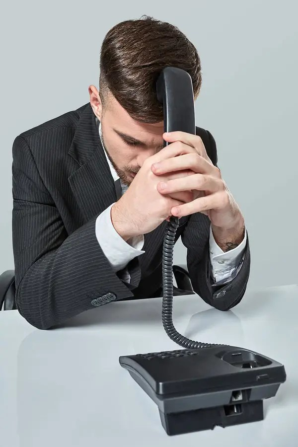 man in office with black phone