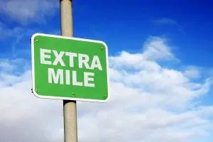 Extra mile green sign