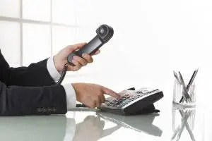 Businessman Hands Dialing Out