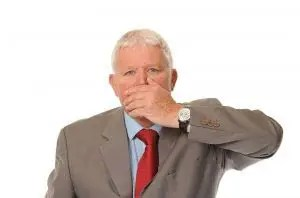 Mature businessman covering mouth