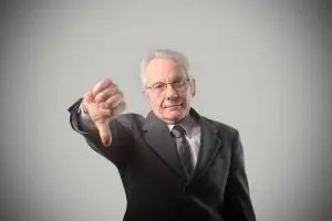 Senior businessman with thumbs down