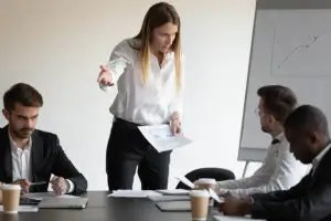 Female Boss And Employee Having Conflict During Meeting In Board