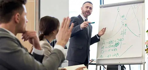 Sales person standing at a flipchart giving a presentation