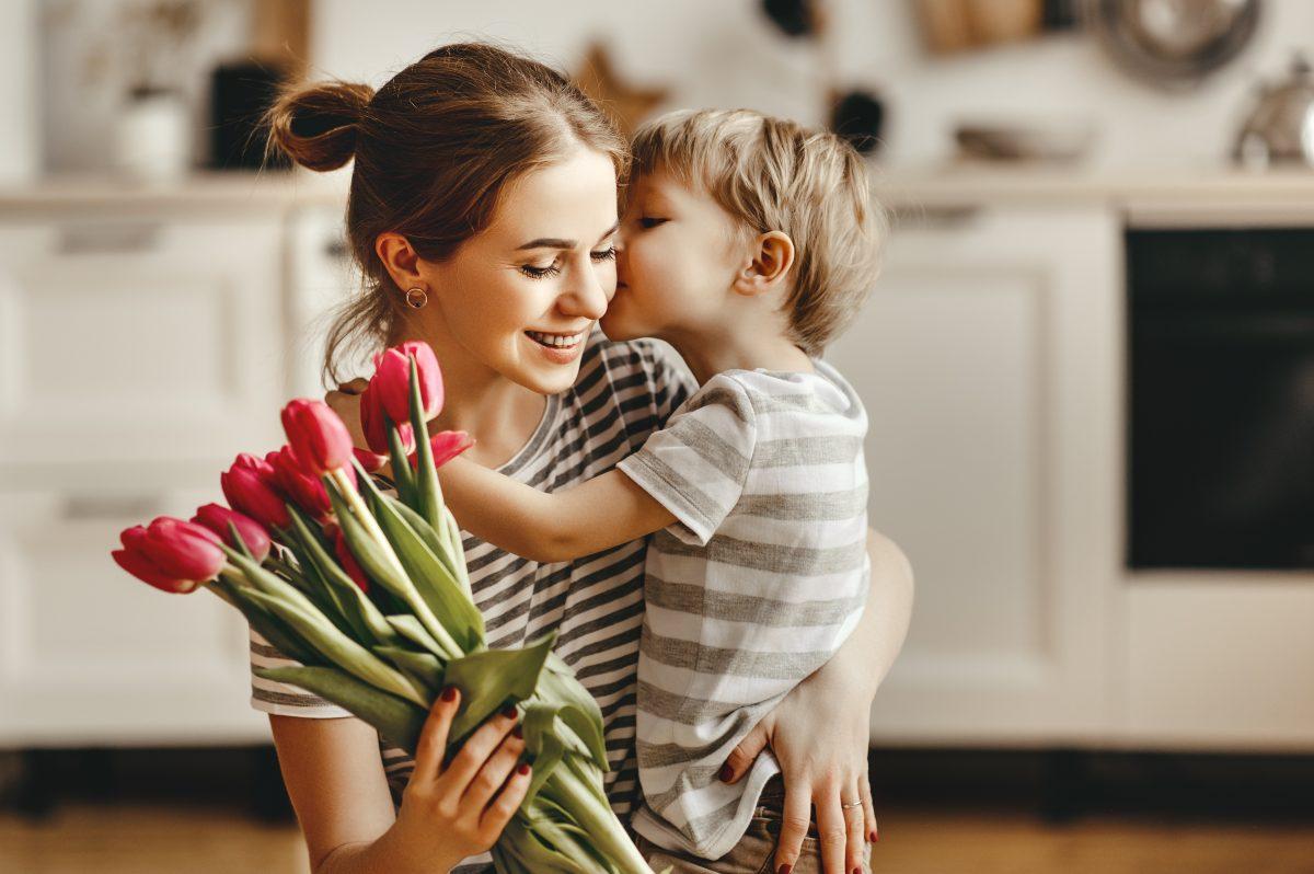 Boy giving mom a kiss