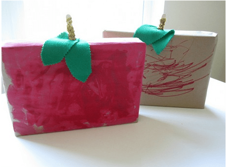Recycled art projects of cereal box apples