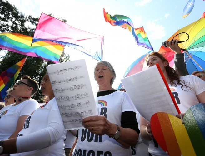 LGBT rainbow choir protests outside World Meeting of ...
