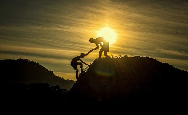 Tips To Increase Self-Control Person Helping Another Person Climb