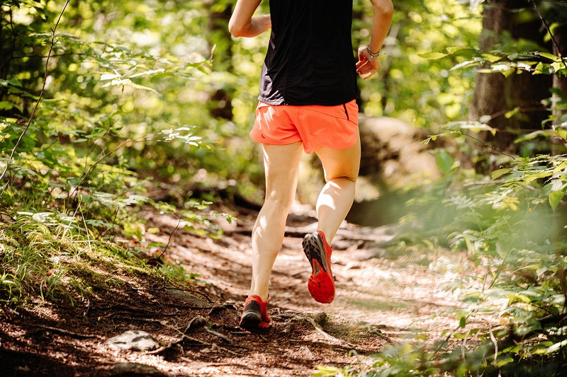 Herbalife24 Products Close Up of a Man's Legs as He Runs on a Trail Through Some Trees