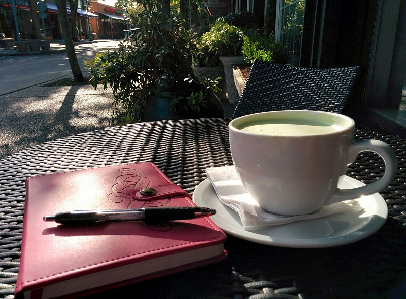 Energy Boosting Tea Recipes A Cup of Tea on a Table Outside with a Journal On the Table