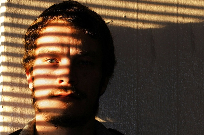 Herbalife Men's Health Product Benefits Man with Sunlight on His Face Coming Through Blinds