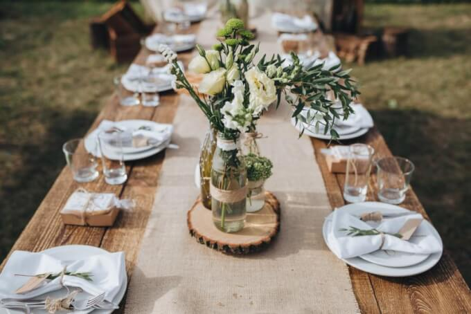 Compose a romantic centerpiece with salvaged objects
