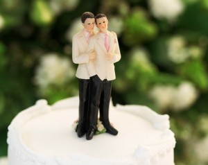 two men on top of a wedding cake