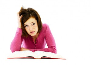 Frustrated woman looks at the love rule book