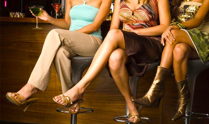 three_young_women_sitting_at_a_bar_LV0010014d