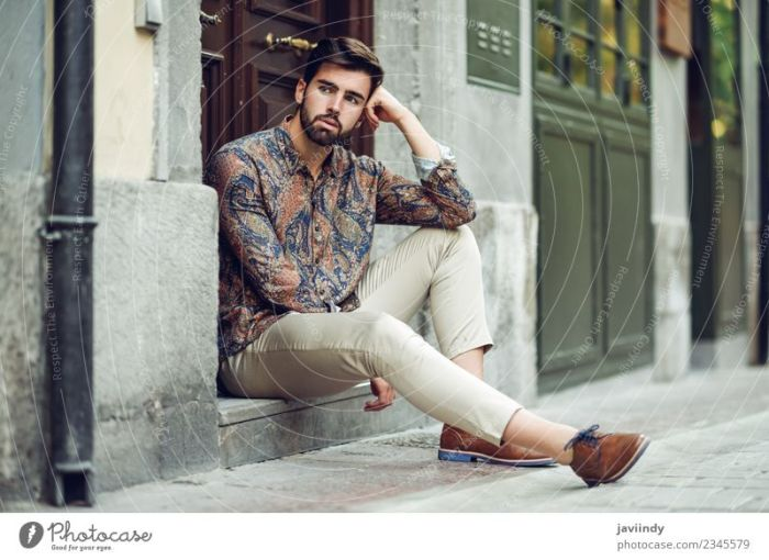 Young bearded man  model of fashion  sitting on urban step   a     Young bearded man  model of fashion  sitting on urban step   a Royalty Free  Stock Photo from Photocase