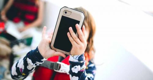 kid with cell phone