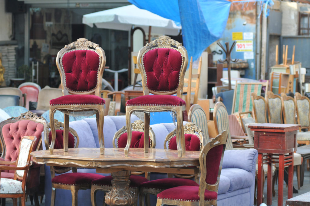 How to Check for Pests Before Buying Used Furniture   ZING Blog by     Antique Chairs on a table at flea market