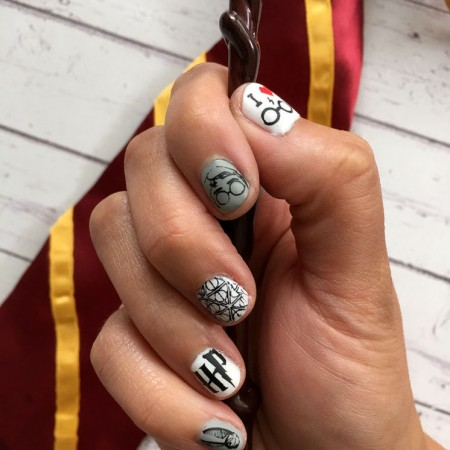 Awesome nail stamping tutorial for darling Harry Potter manicure