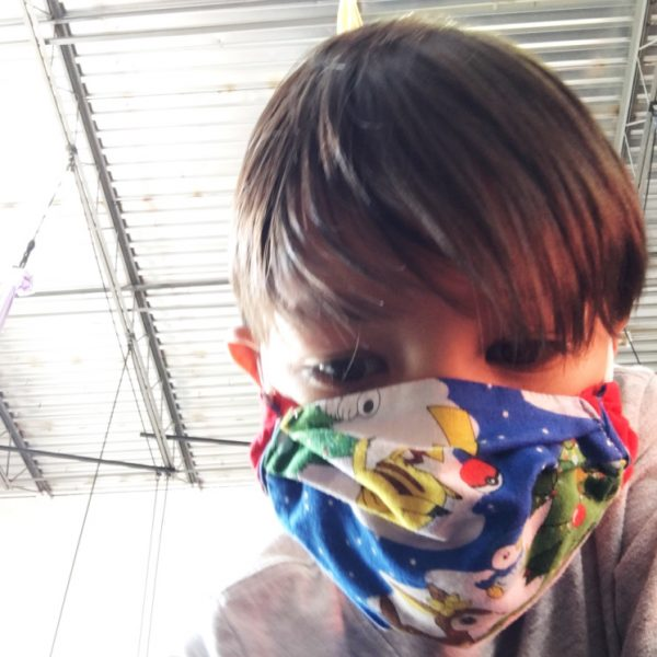 boy wearing 3D face mask origami box style