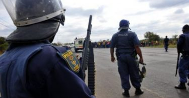 7 suspects accused of killing South African police officers killed in church gunfight