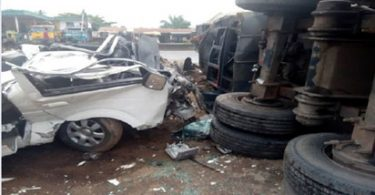 15 passengers escape death as truck crushes a 14-seater bus